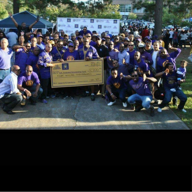 Brothers of Omega Psi Phi Lead the Way in Giving Back During Homecoming Weekend